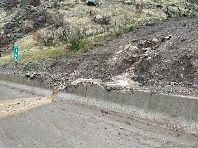 Water and debris flow onto Interstate 70 in Glenwood canyon, necessitating a closure.